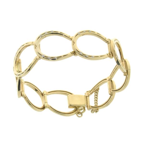 Armband aus 9 Hufeisen und Brillanten